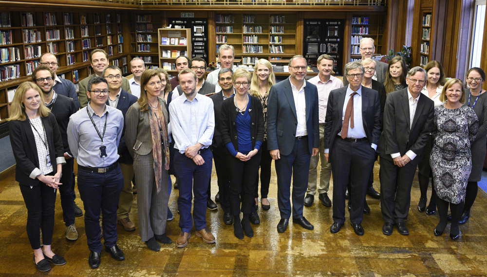 Bill Gates and School staff in the School's library. Anne Koerber / LSHTM