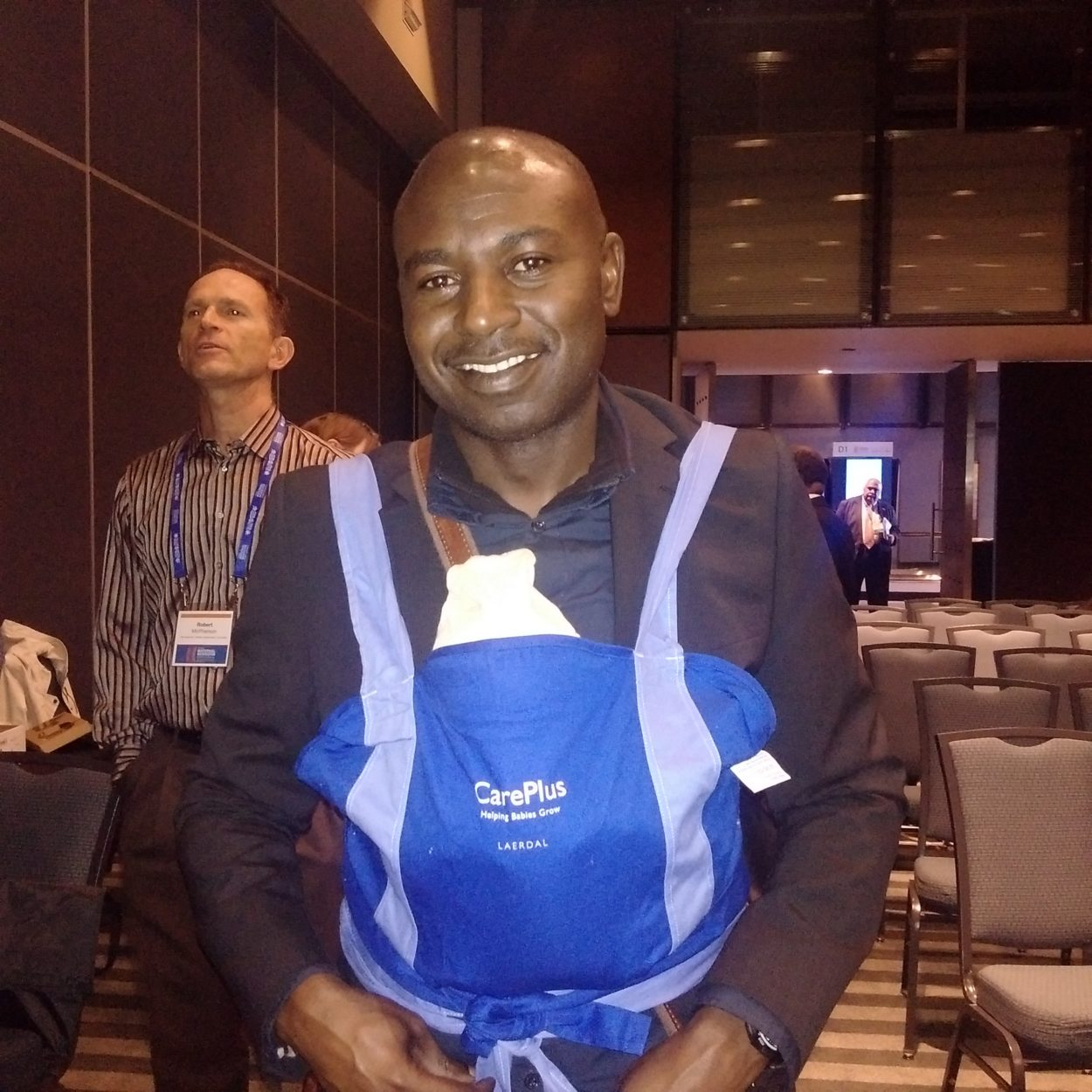 Dr Nasir Umar, IDEAS Country Coordinator, Nigeria, tries out Kangaroo Mother Care at the Global Maternal and Newborn Health Conference, Mexico, October 2015