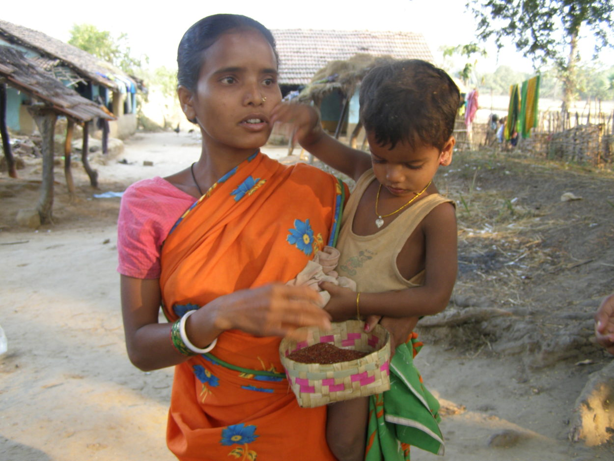 Asha, with child and ragi, a local millet