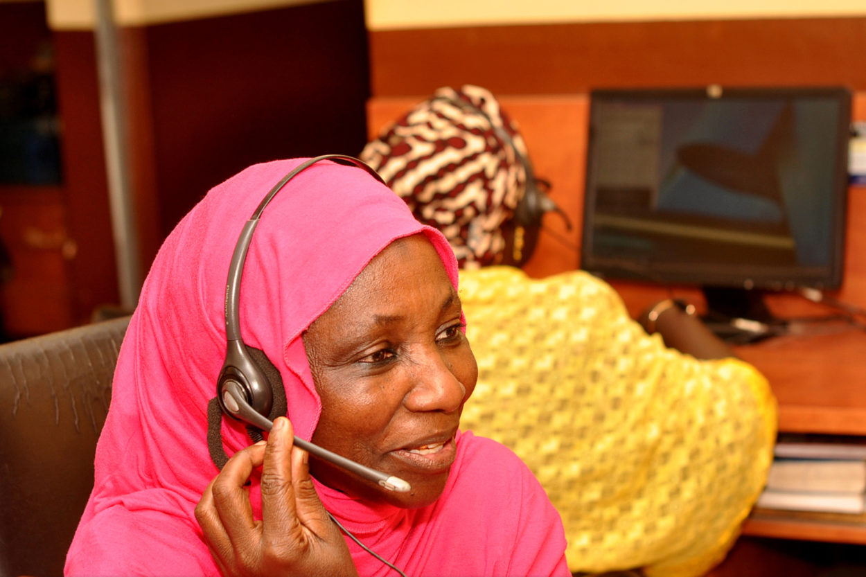 Maryam Kole replies to a call in the call center for the emergency transport scheme